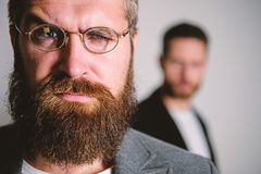 Optics and vision concept. Eyeglasses accessory for smart appearance. Wise glance. Hipster style and fashion. Hipster. Eyeglasses. Man handsome bearded hipster stock images