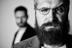 Optics and vision concept. Eyeglasses accessory for smart appearance. Wise glance. Hipster style and fashion. Hipster. Eyeglasses. Man handsome bearded hipster royalty free stock photo