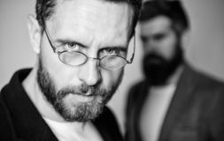 Optics and vision concept. Smart glance. Accessory for smart appearance. Wearing glasses may really mean you are smarter. Man handsome bearded mature guy wear stock image