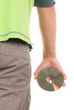 Optikal disk in hand behind. On white background Royalty Free Stock Images