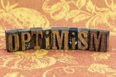 Optimism positive attitude letterpress. Optimism hope day dream plan planning positive attitude inspiration message letterpress type wood letters Stock Photography