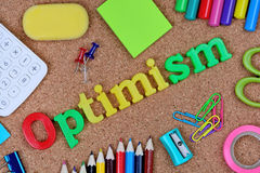 Optimism word on cork. Background Royalty Free Stock Images