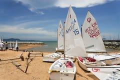 Optimist boats on shore Stock Photography