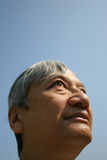 Optimistic. Asian man looking into the sky Royalty Free Stock Images