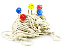 Optimistic. Smiley paper clips pricked into a ball of string. Conceptual shot for staying optimistic in a tangled/difficult situation royalty free stock photo