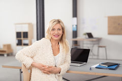 Optimistic Adult Office Lady Sitting at her Table Stock Image