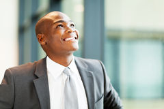 Optimistic african businessman. Optimistic african american businessman looking up Royalty Free Stock Photography
