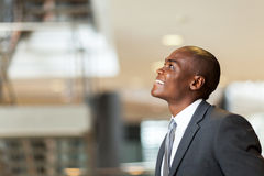 Optimistic african businessman. Optimistic african american businessman looking up Stock Photos