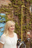 Optimistic Blond Adult Woman Looking Into Distance Royalty Free Stock Photography