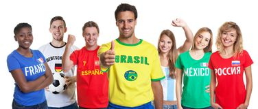 Optimistic brazilian soccer supporter with fans from other count royalty free stock photo