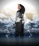 Optimistic Business Man in Storm Water Stock Photo