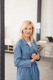 Optimistic Businesswoman Holding Tablet Computer Stock Photos