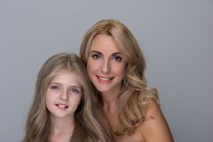 Optimistic charming woman and little girl are expressing gladness royalty free stock image