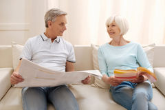 Optimistic clever elderly couple sharing their thoughts Stock Photo