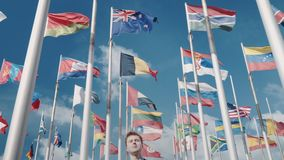 An optimistic clip of the unity of all countries and nations and a bright future against the background of the flags of. Symbols of unity of all countries and a stock footage