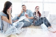 Optimistic colleagues communicating on the telephone Stock Photos