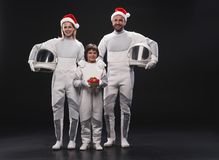 Optimistic couple of astronauts with their child are expressing happiness stock images