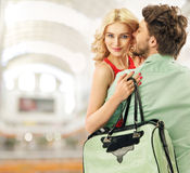 Optimistic couple spending leisure in a mall Stock Image