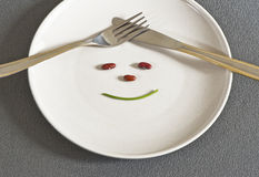 Optimistic Diet. On a diet with a smile Stock Photography