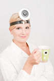 Optimistic female doctor with cup of coffe Royalty Free Stock Images