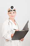 Optimistic female doctor with folder Royalty Free Stock Image