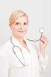 Optimistic female doctor with stethoscope Royalty Free Stock Photography