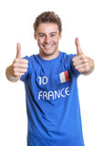 Optimistic french soccer fan Stock Photos