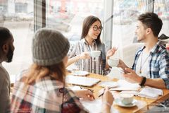 Optimistic friends drinking tea in the restaurant Royalty Free Stock Images