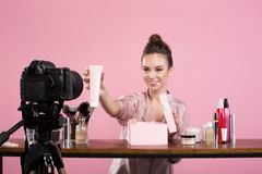 Optimistic girl is filming review for her vlog stock photo