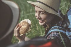 Optimistic girl is holding some snack royalty free stock photography