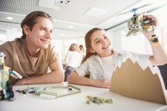 Optimistic girl and teacher gaming with toy royalty free stock images
