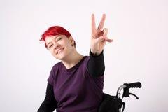 Optimistic Girl in wheelchair. Isolated Stock Photos