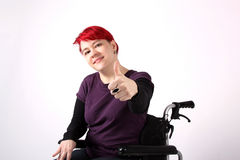 Optimistic Girl in wheelchair with thumbs up Stock Images