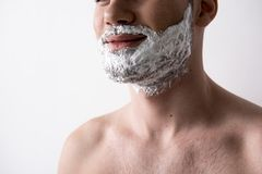 Optimistic guy is going to shave royalty free stock image