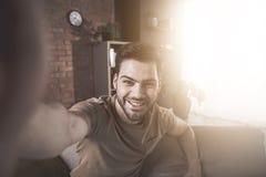 Optimistic guy is making photo stock image
