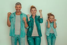 Optimistic. Happy family having success winner pose royalty free stock images