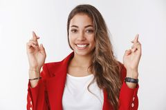 Optimistic happy woman making wish smiling aimed success, cross fingers good luck grinning looking camera hopeful. Excited, waiting positive results, praying royalty free stock image