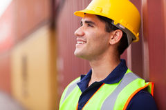 Optimistic harbor worker. Optimistic young harbor worker in container yard Royalty Free Stock Image