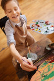 Optimistic little boy painting and relaxing at school Royalty Free Stock Photos
