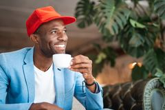 Optimistic male drinking cup of coffee Stock Photos