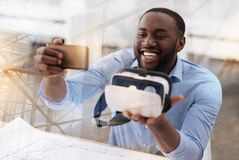 Optimistic man with virtual glasses taking selfie Stock Photography