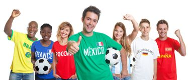 Optimistic mexican soccer supporter with ball and fans from othe royalty free stock image