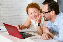 Optimistic middle aged couple expressing positivity at home Royalty Free Stock Image