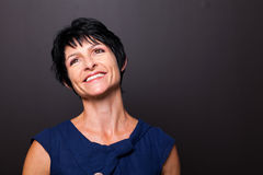 Optimistic middle aged woman. Portrait on black background Royalty Free Stock Photography