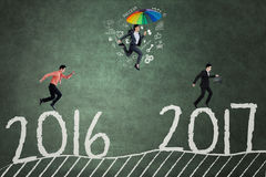Optimistic people compete toward 2017 Royalty Free Stock Photo