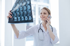 Optimistic radiologist analyzing roentgen results at the laboratory Royalty Free Stock Photo