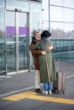 Optimistic senior lady and gentleman are hugging outdoors. Happiest meeting. Full length of cheerful aged couple is standing and embracing each other near Stock Images