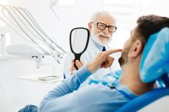 Optimistic stomatologist with a patient Stock Photos