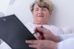 Optimistic test results. Test results are very optimistic for elder female patient Stock Photos