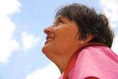 Optimistic woman. Looking up blue sky Stock Images